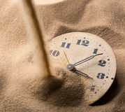 Face of clock in sand Stock Image