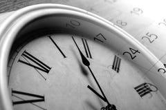 Face clock and sheet of a calendar Stock Photography