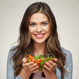 Face close up portrait of happy woman eating salad. Stock Photos