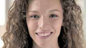 Face close up of smiling curly hair woman stock video footage