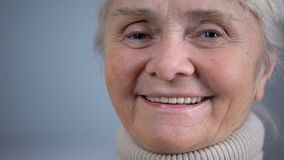 Face close-up of smiling elderly woman, social security, taking care in old age. Stock footage stock video footage