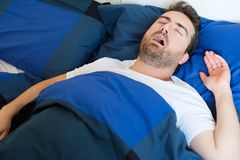 Face close up of snoring man because of hypopnea disorder Stock Photos