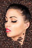 Face with closed eyes in the coffee beans Stock Image