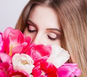 Face, closed eyes, tulips Royalty Free Stock Photography