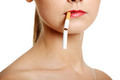 Face closeup with a cigarette. Royalty Free Stock Images
