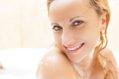 Face Closeup of Happy and Smiling Caucasian Blond woman Taking Bath Royalty Free Stock Photography