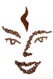 Face by coffee beans Royalty Free Stock Image