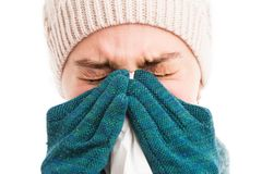 Face of a cold woman sneezing or blowing her nose stock image