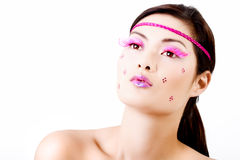 Face with colorful makeup and eyelashes Royalty Free Stock Images