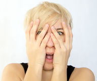 Face covered with hands Royalty Free Stock Photography