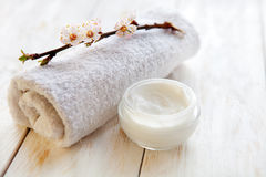 Face cream with apricot blossom on white wooden table Royalty Free Stock Image