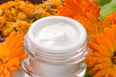Face cream and calendula flowers Stock Image