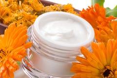 Face cream and calendula flowers Stock Image