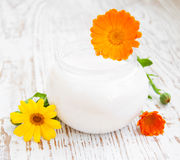 Face cream and calendula flowers Royalty Free Stock Image