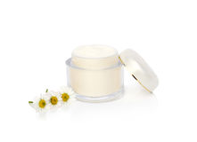 Face cream and chamomile Royalty Free Stock Photography