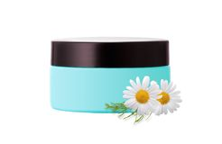 Face cream and chamomile flowers isolated on white Stock Photos