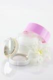Face-cream and eyeshadow Stock Photos