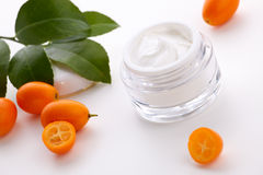 Face cream and fresh cumquats Royalty Free Stock Images