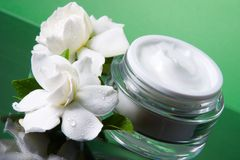 Face cream and gardenias Royalty Free Stock Images
