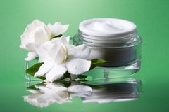 Face cream and gardenias Stock Image