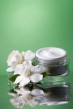 Face cream and gardenias Stock Photo