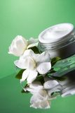 Face cream and gardenias Royalty Free Stock Image