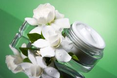 Face cream and gardenias Royalty Free Stock Photos