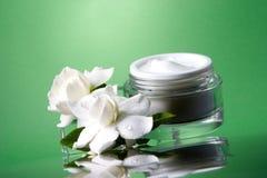 Face cream and gardenias Royalty Free Stock Image