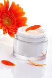 Face cream and gerbera flowers Stock Photography