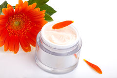 Face cream and gerbera flowers Royalty Free Stock Image