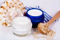 Face cream in jars with sea salt and shell Royalty Free Stock Images