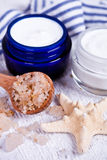 Face cream with sea salt and star Royalty Free Stock Photo