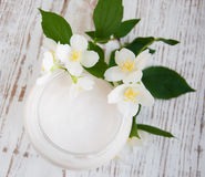 Face cream with jasmine flowers Stock Images
