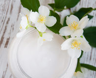 Face cream with jasmine flowers Stock Photography