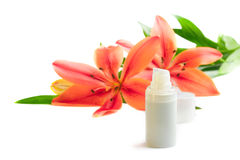Face cream with lily flowers, on white Royalty Free Stock Photography