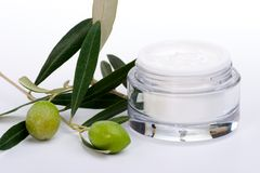 Face cream and olive twig. Closeup of jar of moisturizing face cream and twig with green olives Stock Photos