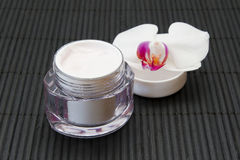 Face cream and orchid Royalty Free Stock Photo