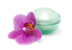 Face cream and orchid isolated on white background Royalty Free Stock Photo