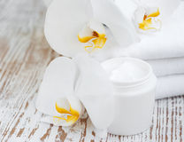 Face cream with orchids flowers Royalty Free Stock Photos