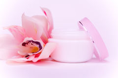 Face cream and pink orchid Stock Photo