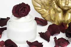 Face cream with roses Royalty Free Stock Photos