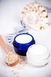 Face cream, sea salt and shell Stock Photo