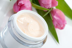 Face cream and tulips Stock Photo