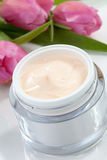 Face cream and tulips Stock Images