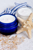 Face cream wiith sea salt and star Royalty Free Stock Photography