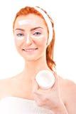 Face cream woman applying skin cream under eyes Stock Photo