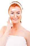Face cream woman applying skin cream under eyes Stock Images