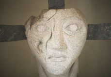 Face on a cross Stock Image