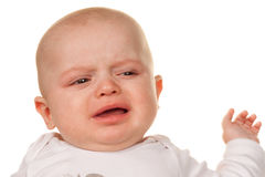 Face of a crying, sad babies Stock Photos