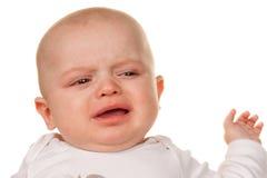 Face of a crying, sad babies Stock Photos